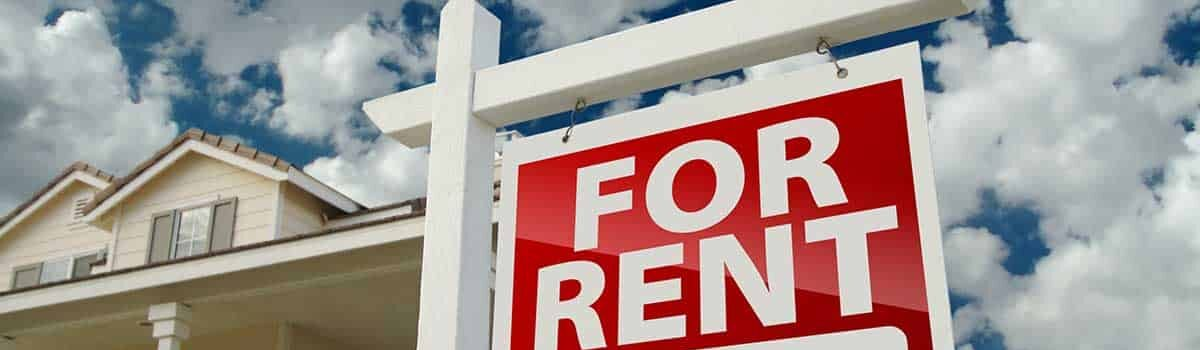 for rent sign on lawn on a cloudy day Bergan & Company Property Management Denver, Centennial, Colorado