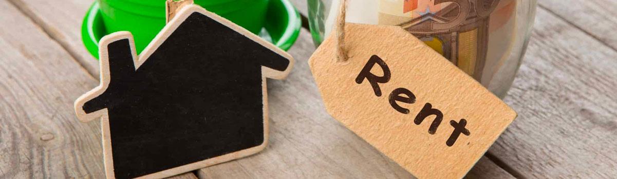 small cardboard cutout of home and rent sign Bergan & Company Property Management Denver, Centennial, Colorado